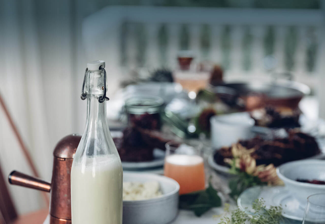Milk in glass bottle on breakfast table
