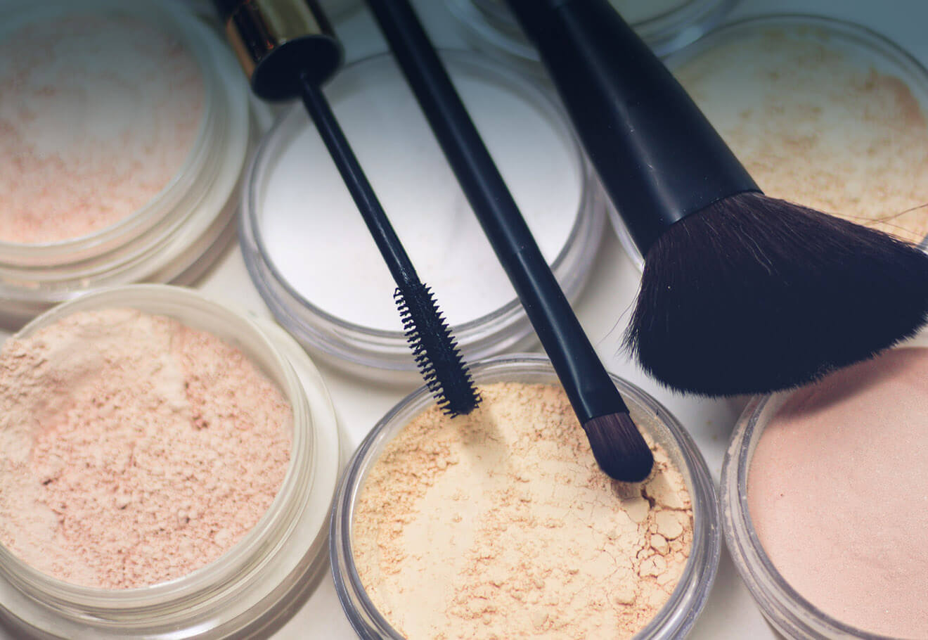 Set of makeup powders and brushes