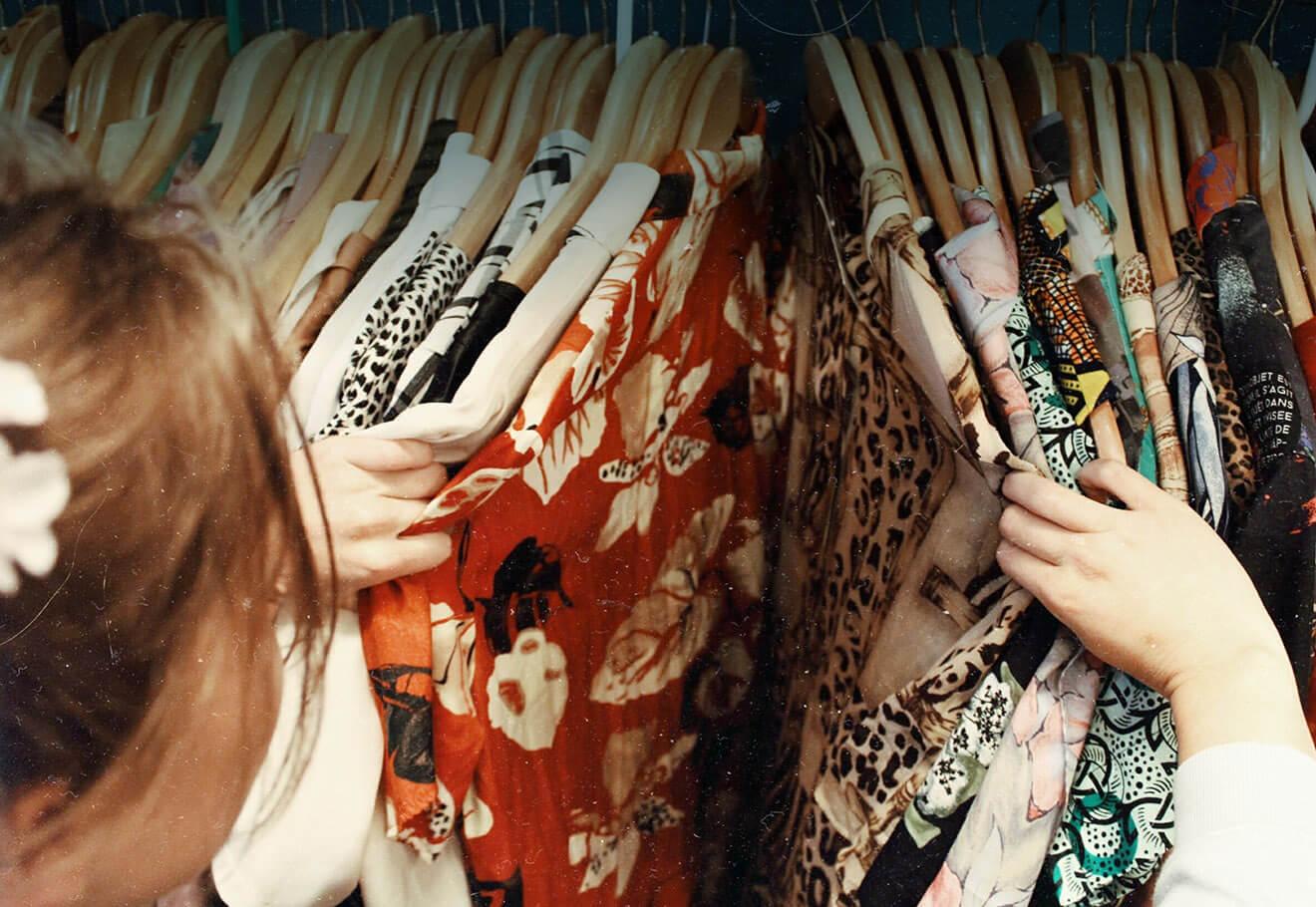 Girl browsing through wardrobe