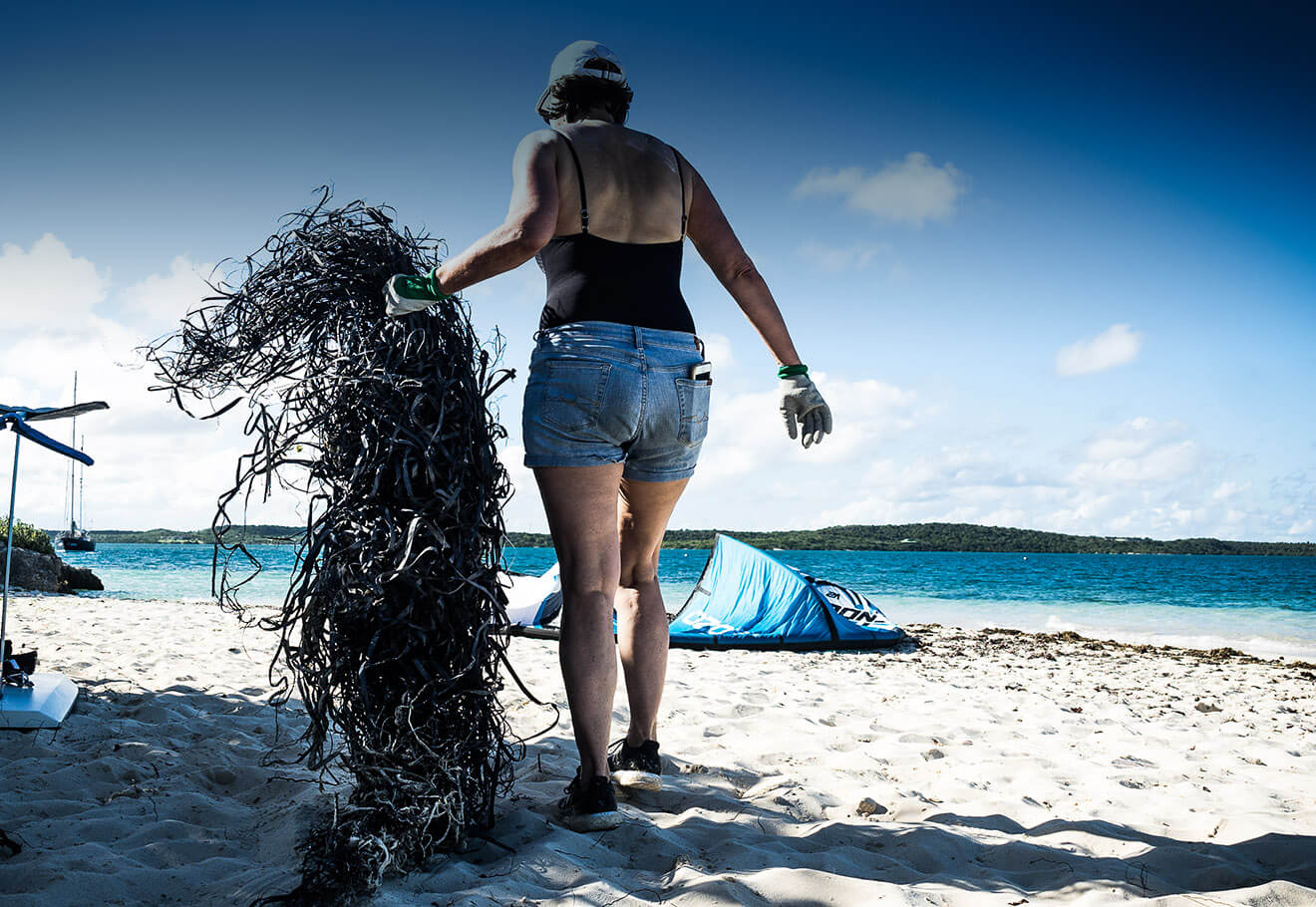 Cleaning up fishing nets from a beach