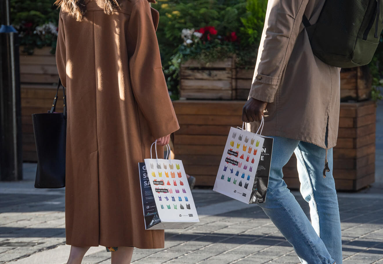 People holding reusable paper bags