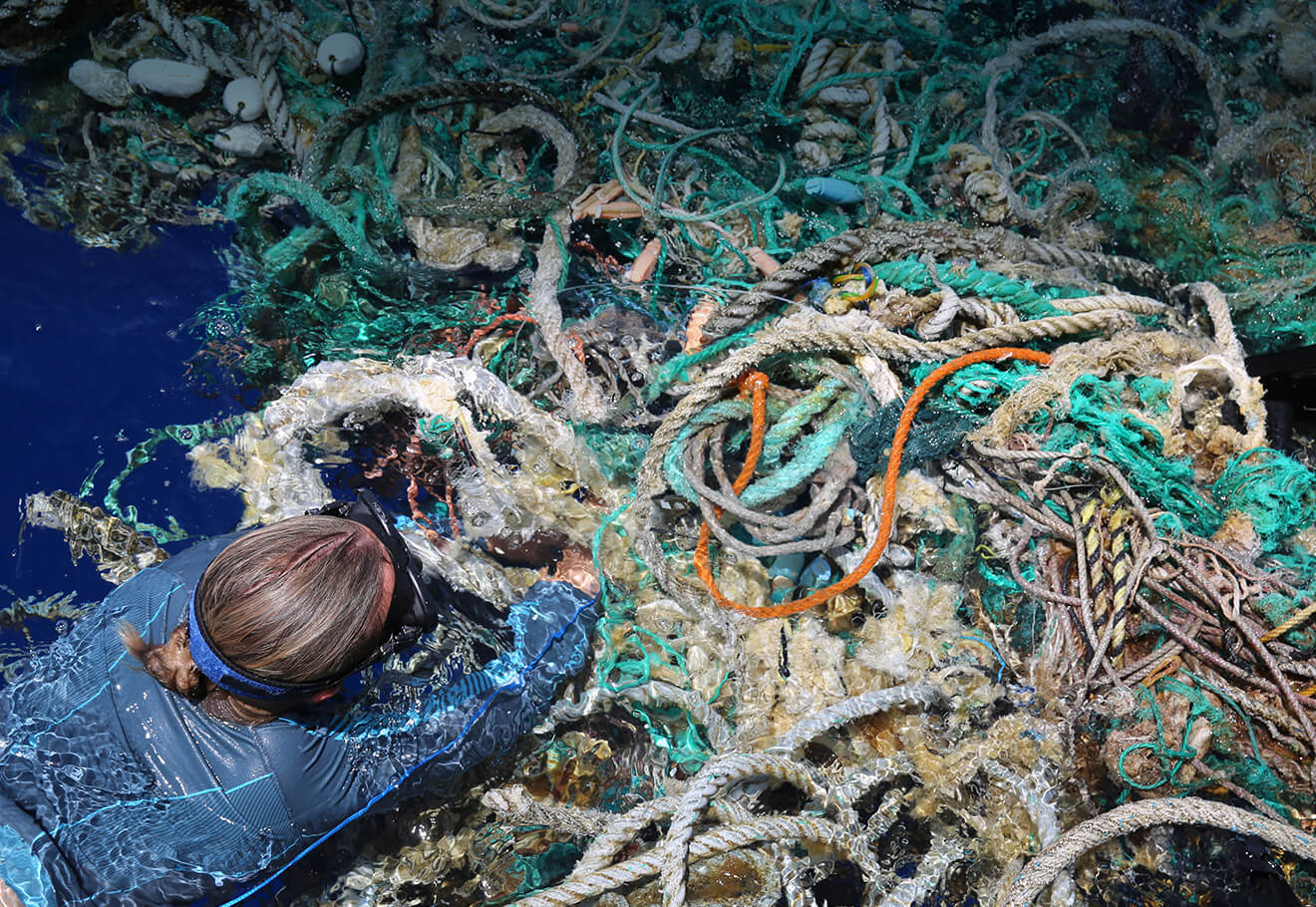 eXXpedition diver tagging a ghost net in the middle of North Pacific
