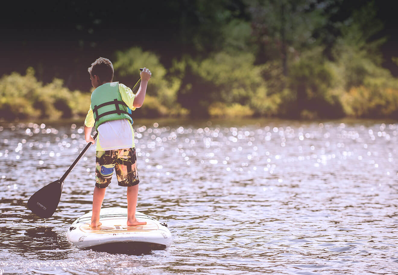 Child stand up paddleboarding