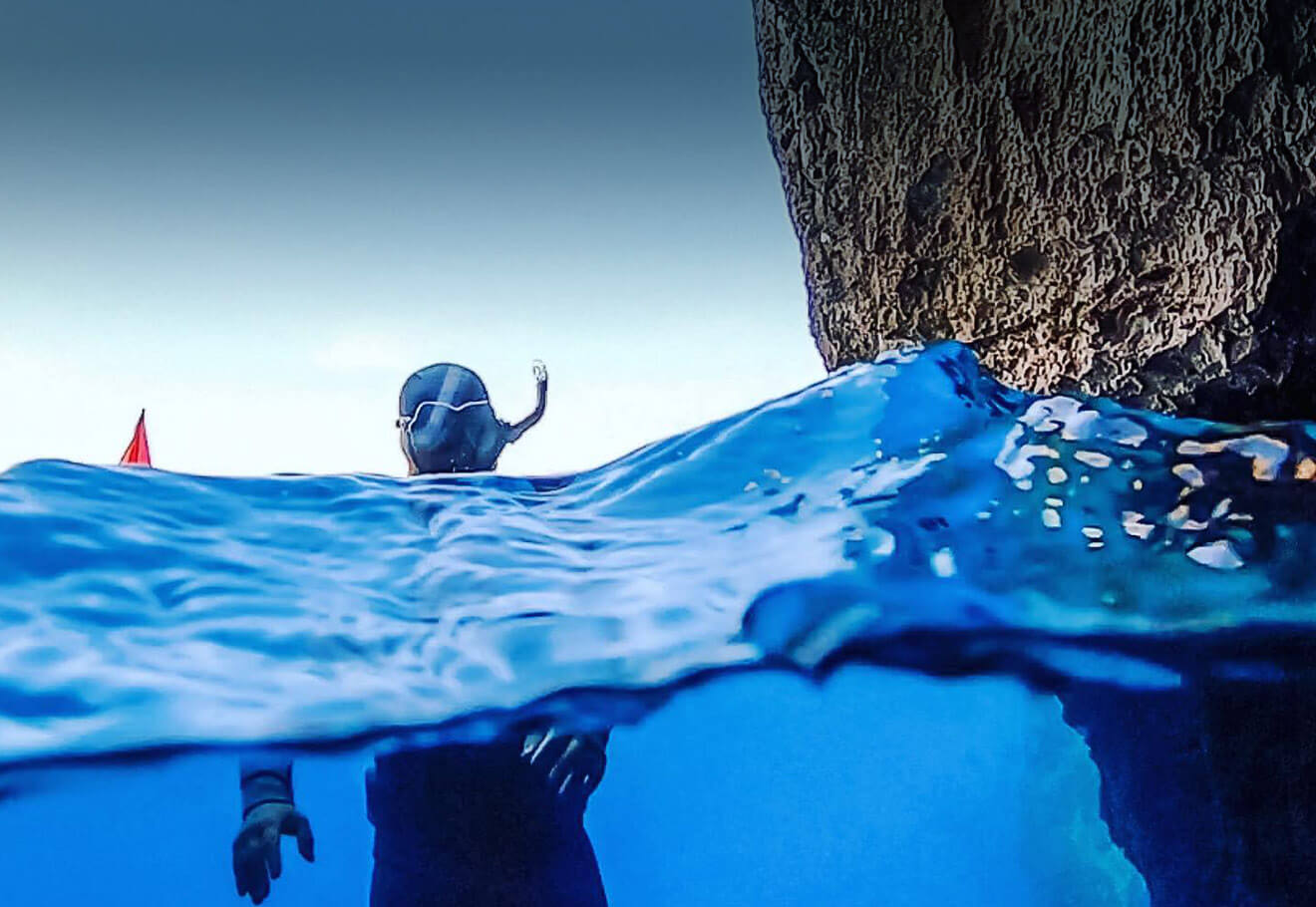 Snorkeling alongside coastline