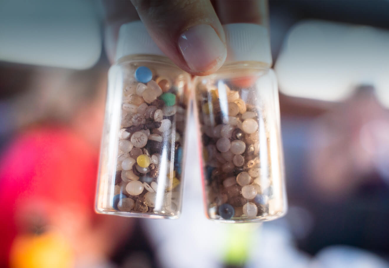 Sample jars containing plastic nurdles