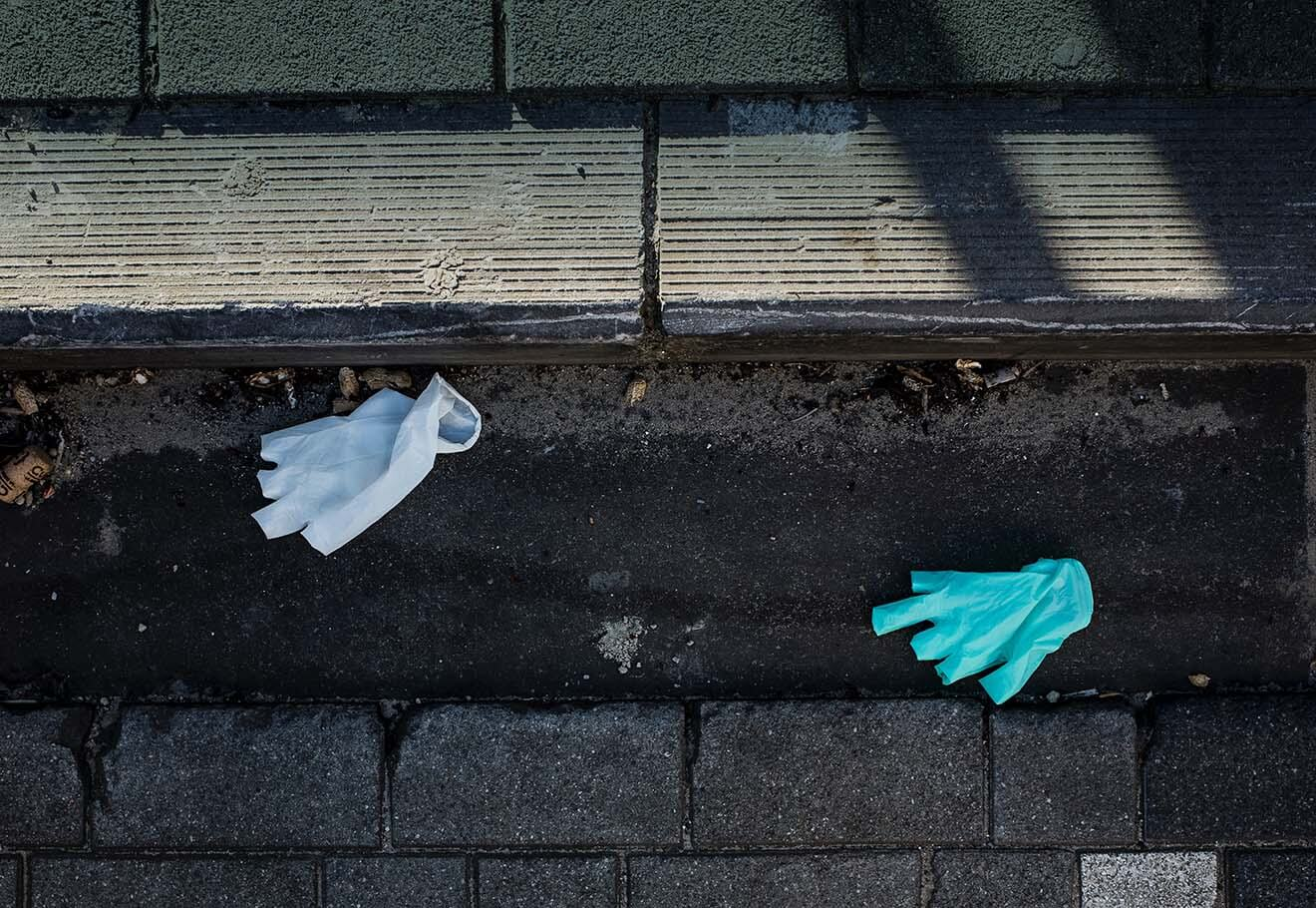 Disposable latex gloves littered on the ground