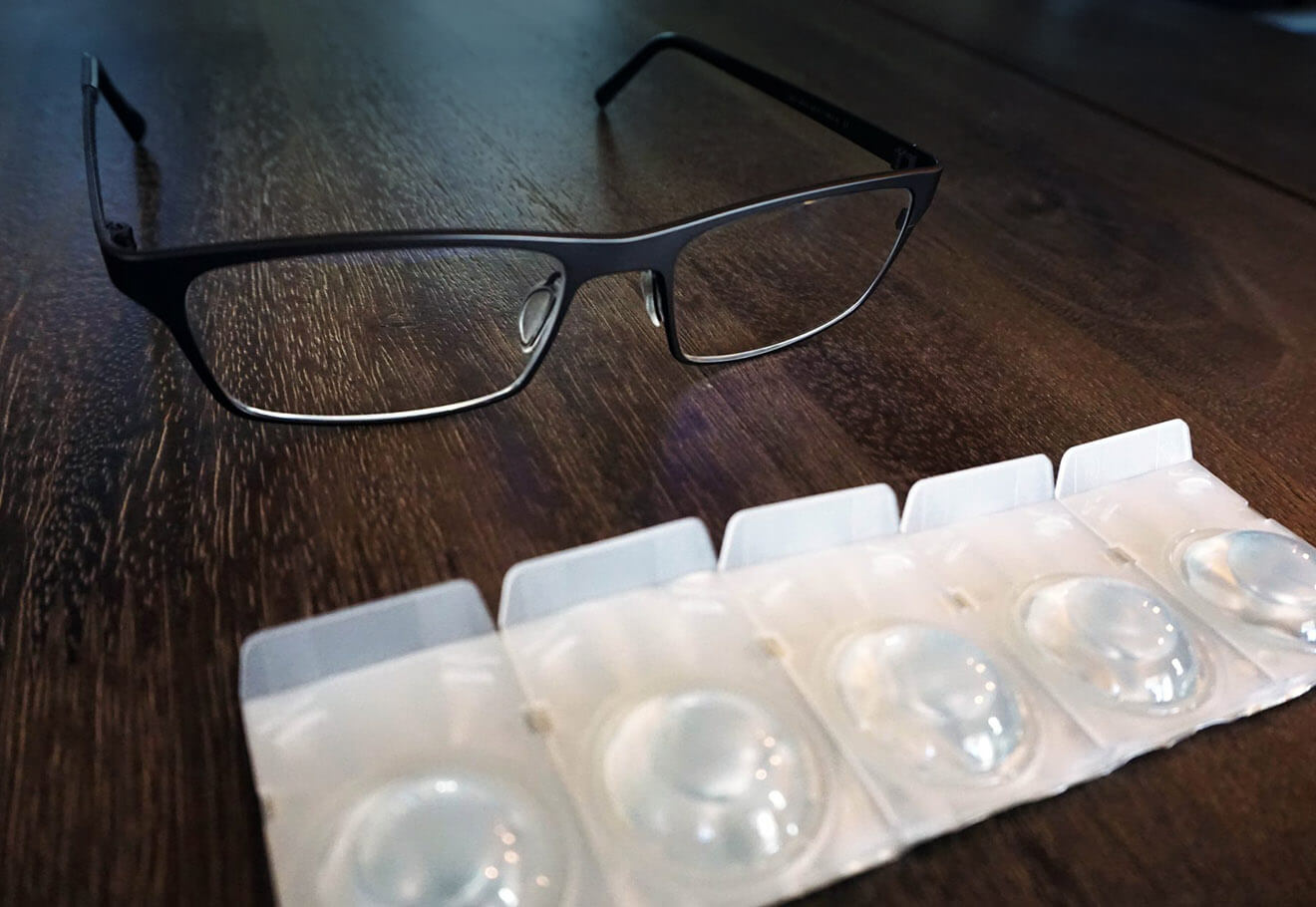 Contact lens packaging and glasses