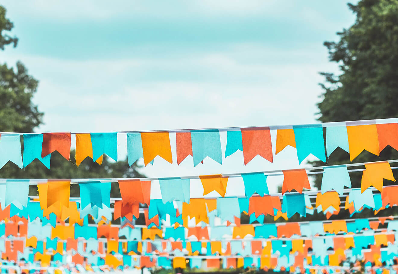 Colourful bunting decor at an outdoor party