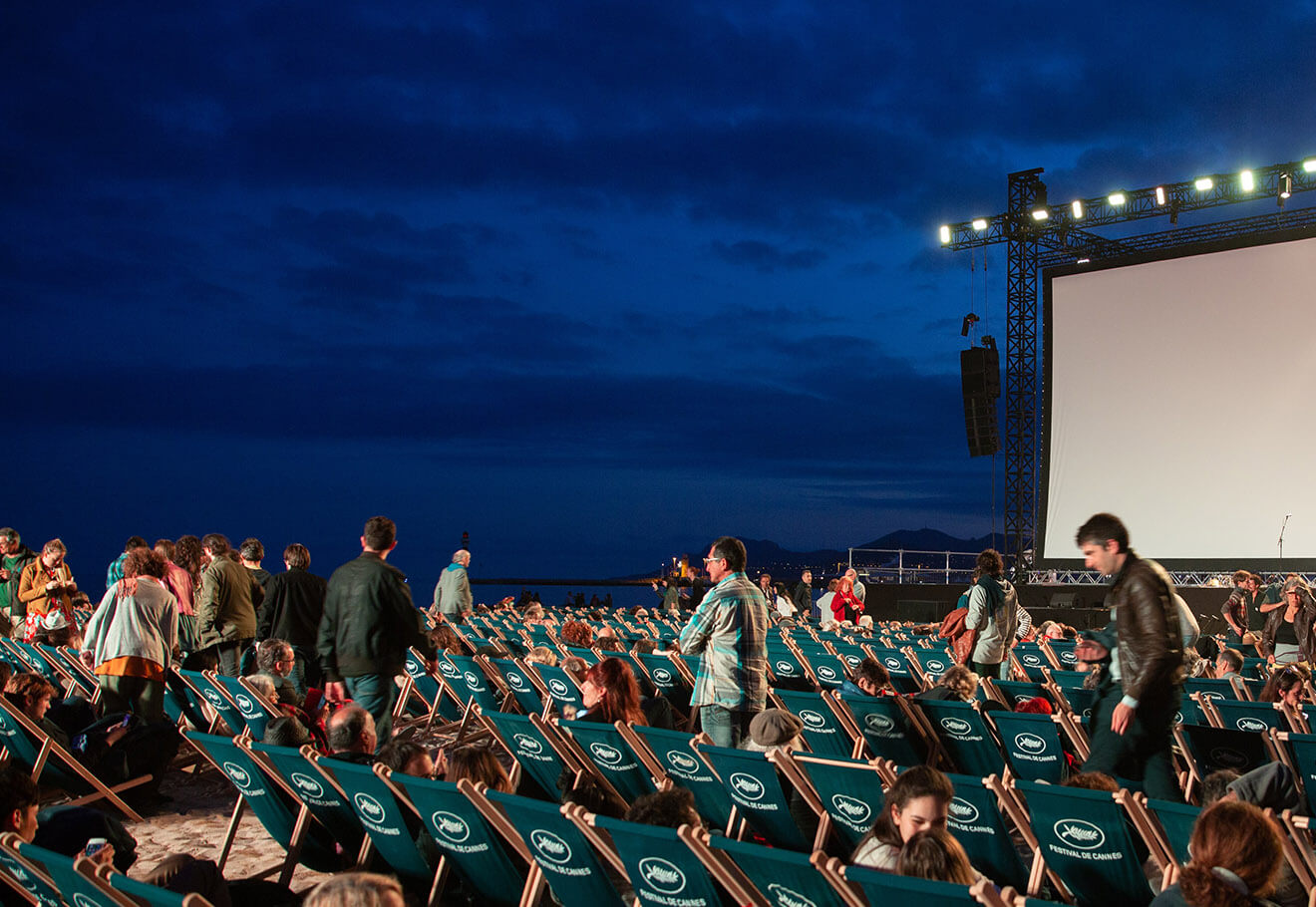 Outdoor film screening on a beach