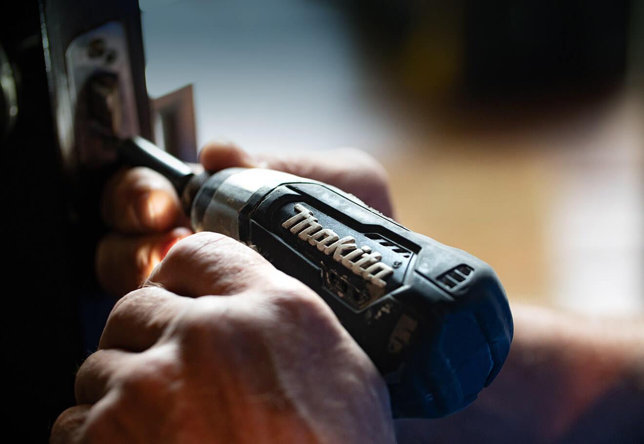 Using screwdriver to repair items